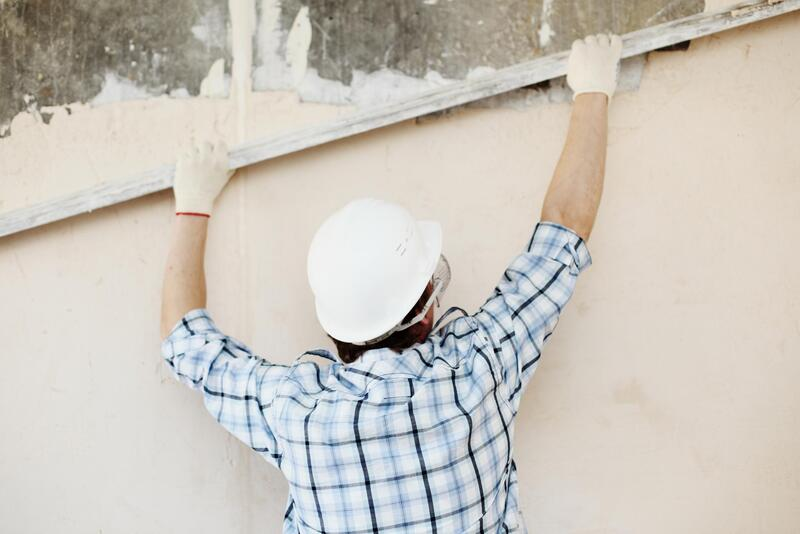 man leveling the wall